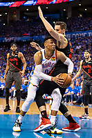 OKLAHOMA CITY, OK - APRIL 21: Russell Westbrook #0 of the Oklahoma City Thunder tries to get a shot off against Zach Collins #33 of the Portland Trail Blazers during Round One Game Three of the 2019 NBA Playoffs on April 21, 2019 at Chesapeake Energy Arena in Oklahoma City, Oklahoma  NOTE TO USER: User expressly acknowledges and agrees that, by downloading and or using this photograph, User is consenting to the terms and conditions of the Getty Images License Agreement.  The Trail Blazers defeated the Thunder 111-98.  (Photo by Wesley Hitt/Getty Images) *** Local Caption *** Russell Westbrook; Zach Collins