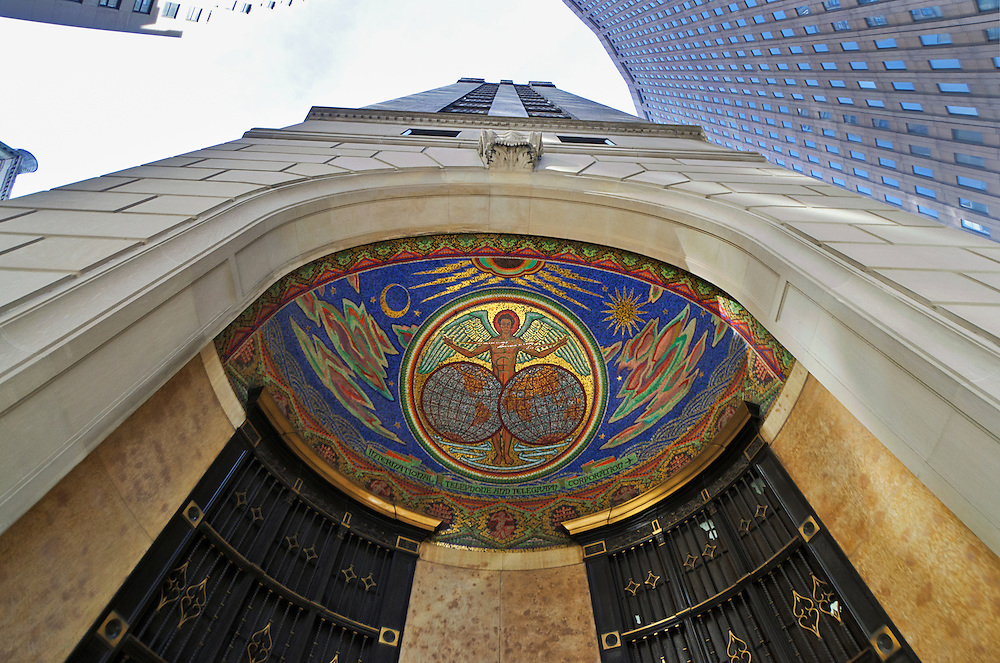 The International Telephone and Telegraph (ITT) Building, Southwestern  entrance has a mosaic dome depicting commerce uniting the hemispheres with electricity. New York City, New York, USA