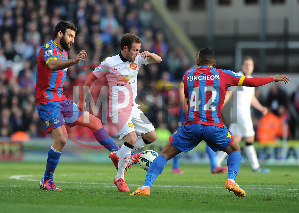 Manchester United's Juan Mata goes on the attack against Crystal Palace's Jason Puncheon - Photo mandatory by-line: Alex James/JMP - Mobile: 07966 386802 - 09/05/2015 - SPORT - Football - London - Selhurst Park - Crystal Palace v Manchester United - Barclays Premier League