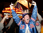 Cubs fans Grant Platek celebrates Wednesday outside of Wrigley Field after the Cubs defeated the Cleveland Indians in Game 7 to win the World Series.
