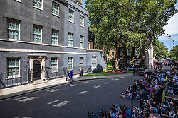 © Licensed to London News Pictures. 24/07/2019. London, UK. Philip May wraps his arm around Theresa May as she leaves Downing Street. Boris Johnson will become the next Prime Minister this afternoon. Photo credit: Rob Pinney/LNP