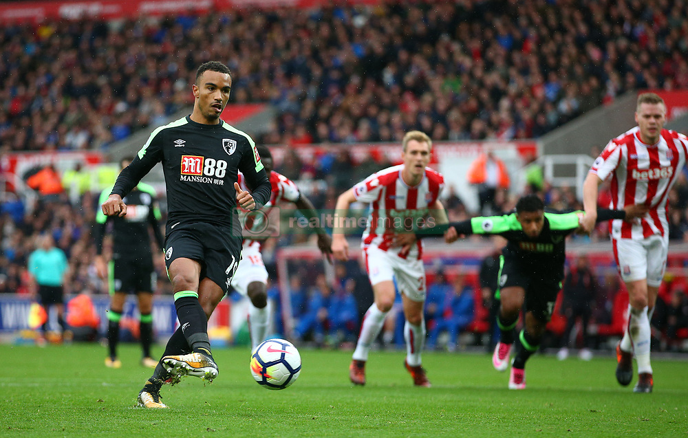 AFC Bournemouth's Junior Stanislas scores his side's first goal from the penalty spot during the Premier League match at the bet365 Stadium, Stoke-on-Trent.