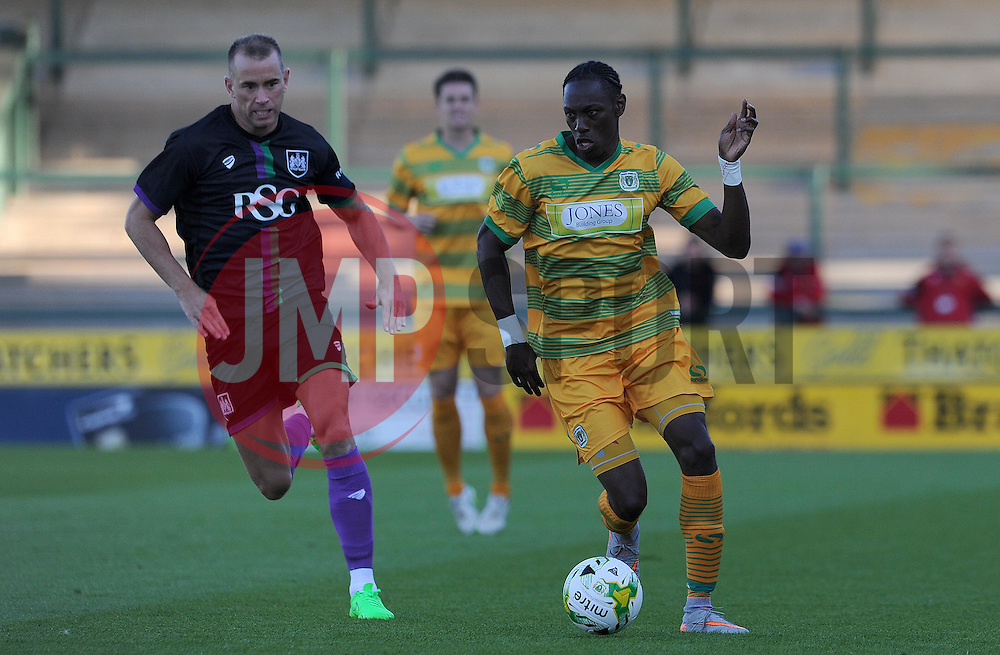 Yeovil Town's Nathan Smith is tackled by Bristol City's Aaron Wilbraham- Photo mandatory by-line: Harry Trump/JMP - Mobile: 07966 386802 - 30/07/15 - SPORT - FOOTBALL - Pre Season Fixture - Yeovil Town v Bristol City - Huish Park, Yeovil, England.