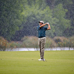 Apr 23, 2015; Avondale, LA, USA; Mark Hubbard on the 18th hole as rain begins to fall during the first round of the Zurich Classic at TPC Louisiana. Mandatory Credit: Derick E. Hingle-USA TODAY Sports