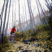 Heather Goodrich rides the East Vail trail during autumn in Vail Colorado.