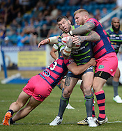 Andy Bostock (R) of Featherstone Rovers tackles Brett Delaney of Leeds Rhinos during the Super 8s Qualifiers match at The Big Fellas Stadium, Post Office Road, Pontefract.<br /> Picture by Richard Land/Focus Images Ltd +44 7713 507003<br /> 06/08/2016