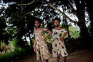 Isattu Jalloh, 11 (right) playing in front of the safe house in Lunsar, Sierra Leone. The girl is 7 months pregant after being raped by an uncle. The grassroot organizer Rugiatu Turay has taken Isattu in and will organize for a C-section in the local hospital.