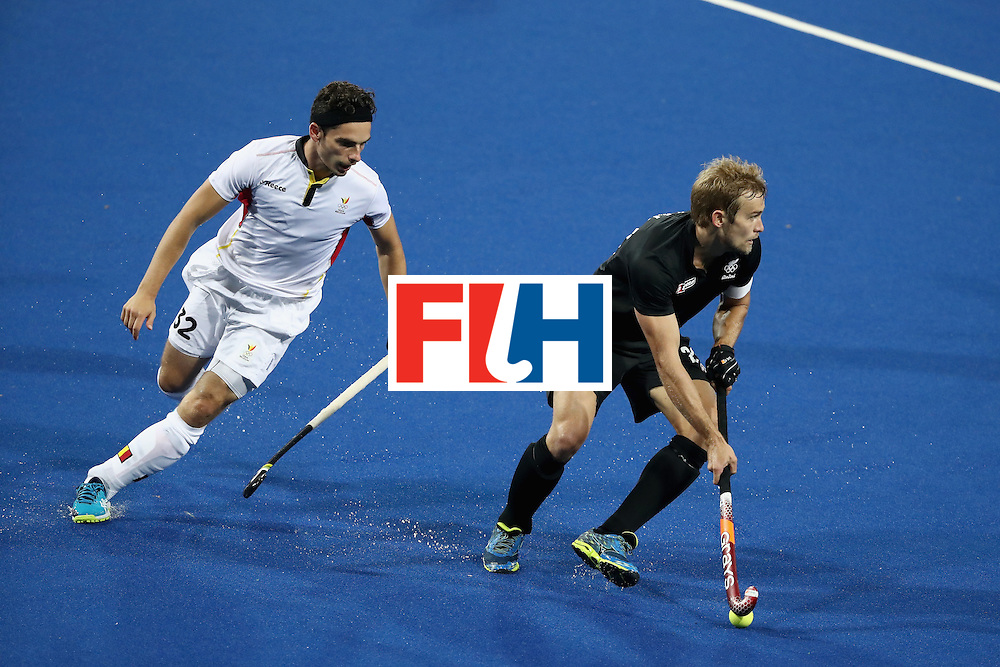 RIO DE JANEIRO, BRAZIL - AUGUST 12:  Tanguy Cosyns #32 of Belgium chases Shay Neal #23 of New Zealand during a Men's Preliminary Pool B match on Day 7 of the Rio 2016 Olympic Games at the Olympic Hockey Centre on August 12, 2016 in Rio de Janeiro, Brazil.  (Photo by Sean M. Haffey/Getty Images)