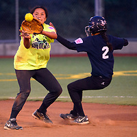 070213  Adron Gardner/Independent<br /> <br /> Din&eacute; Wildcat Jazmya Tannie (14), left, gets the throw from home plate as Gallup All Star Aleya Rivas (2) steals second base at Ford Canyon Park in Gallup Tuesday.
