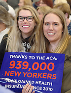 """Westbury, New York, USA. January 15, 2017. L-R, sisters LAUREN GRAB and SUE MOLLER, both from Long Island, hold sign """"Thanks to the ACA 939,000 NEW YORKERS have gained health Insurance since 2010"""" at the """"Our First Stand"""" Rally against Republicans repealing the Affordable Care Act, ACA, taking millions of people off health insurance, making massive cuts to Medicaid, and defunding Planned Parenthood. Hosts were Reps. K. Rice (Democrat - 4th Congressional District) and T. Suozzi (Dem. - 3rd Congress. Dist.)."""