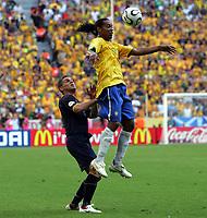 "Ronaldinho is chaalenged by Australia""s Jason Culina<br />Brazil World Cup 2006<br />Brazil V Australia 18/06/06 Group F<br />World Cup 2006<br />Photo Robin Parker Fotosports International"