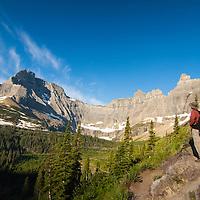 hiker on trail near iceberg lake glacier national park