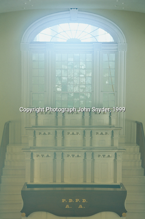 Soft light emanates from windows inside the Kirtland Temple; Kirtland, Ohio. The temple, constructed at great personal sacrifice by early members of the Mormon Church (Church of Jesus Christ of Latter-day Saints) is now owned and maintained by the Community of Christ based in Independence, Missouri.