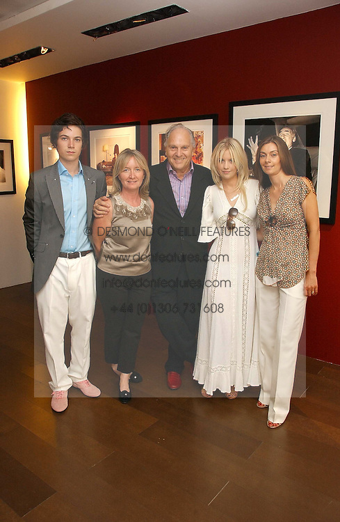 Left to right, MAX MONTGOMERY, MARTINE & DAVID MONTGOMERY, MARISSA MONTGOMERY and REBECCA GOLDBART at an exhibition of photographs by David Montgomery entitled 'Shutterbug' held at Scream, 34 Bruton Street, London W1 on 13th July 2006.<br />