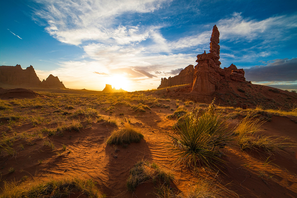 sunset in a remote desert area of wind carved hoodoos and buttes