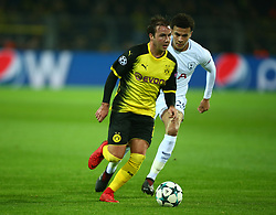 November 21, 2017 - Dortmund, Germany - L-R Mario Gotze of Borussia Dortmund takes on Tottenham Hotspur's Dele Alli  during UEFA Champion  League Group H Borussia Dortmund between Tottenham Hotspur played at Westfalenstadion, Dortmund, Germany 21 Nov 2017  (Credit Image: © Kieran Galvin/NurPhoto via ZUMA Press)
