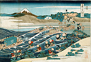 Fuji at Kanaya on the Tokaido Road. From 'Thirty-six Views of Mount Fuji', c1831. Katsushika Hokusai (1760-1849)  Japanese Ukiyo-e artist.  Porters carrying litter, sedan chairs, goods and individuals across the Oi River.  Water Ford