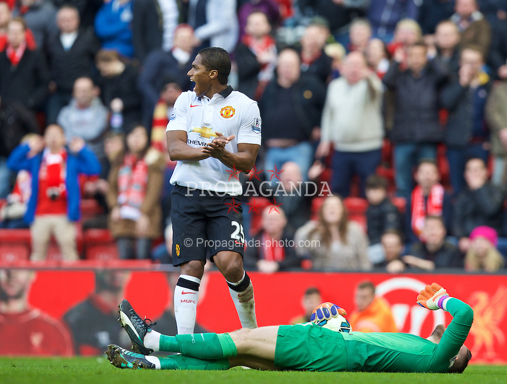 LIVERPOOL, ENGLAND - Sunday, March 22, 2015: Manchester United's goalkeeper David de Gea lies injured after a clash with Liverpool's Martin Skrtel during the Premier League match at Anfield. (Pic by David Rawcliffe/Propaganda)