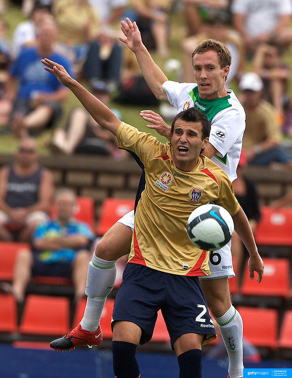 Matthew Smith (top) and Labinot Haliti in action during the Newcastle Jets V North Queensland Fury  A-League match at Energy Australia Stadium, Newcastle, Australia, 20 December 2009. Photo Tim Clayton