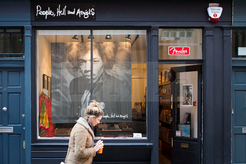 © Licensed to London News Pictures. 02/04/2013. London, UK. A member of the public walks past 'People, Hell and Angels', a pop-up shop set up to celebrate a new album by the late guitar legend in London today (02/04/2013). The shop, located near London's Carnaby Street, runs from the 1st of April until the 12th of April 2013 and features memorabilia, music and photographs of the guitarist and singer who died in 1970 of a drug overdose. Photo credit: Matt Cetti-Roberts/LNP