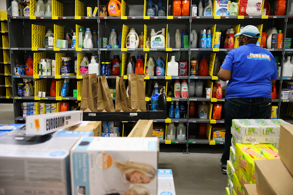 SEQUENCE FOR POSSIBLE GIF Ryan White, Amazon associate, fills shopping bags with products for customers orders at the Amazon.com Inc. Prime Now fulfillment center warehouse on Monday, March 27, 2017 in Los Angeles, Calif. The warehouse can fulfill one and two hour delivery to customers. Complex supply chains such as Amazon's and e-commerce trends will impact city infrastructure and how things move through cities. © 2017 Patrick T. Fallon