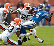 MORNING JOURNAL/DAVID RICHARD.The Browns' secondary of Chaun Thompson, from left, Daylon McCutcheon and Chris Crocker bring down running back Shawn Bryson of Detroit yesterday.