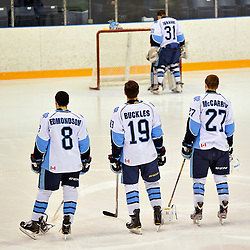 TORONTO, ON - Mar 18 : Ontario Junior Hockey League Playoff Series: 2nd round game between Georgetown Raiders and St. Michaels Buzzers. Ian Edmondson #8, Matt Buckles #19, Patrick McCarron #27 and Adrian Ignagni #31 of the St. Michael's Buzzers during the National Anthem. .(Photo by Shawn Muir / OJHL Images)