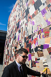 London, UK. 13 September, 2019. A doorman controls access to Martino Gamper's Disco Carbonara installation in Coal Drops Yard as a Festival Commission for the London Design Festival. A 'false facade of a disco with a fresh take on traditional cladding from the Italian Alps', it is designed as a gateway and inspired by the concept of a Potemkin village as built to impress Empress Catherine II by her lover Grigory Potemkin during her journey to Crimea in 1787.