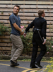 © licensed to London News Pictures. Oxford, UK.  06/09/2011. Grinning Ensar Gol arriving at Oxford Magistrates court today (06/09/2011) where he faces charges of murder. Ensar Gol is accused of murdering his 28 year-old wife Michala Gol and his 50 year-old mother-in-law Julie Sahin at their home in Thame, Oxfordshire.. Photo credit should read Ben Cawthra/LNP