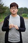 Portrait of a student in the city of Gwangju during the Gwangju Art Biennale.