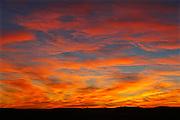 Dramatic clouds at sunset in prarie grasslands (West Block)<br /> Grasslands National Park<br /> Saskatchewan<br /> Canada