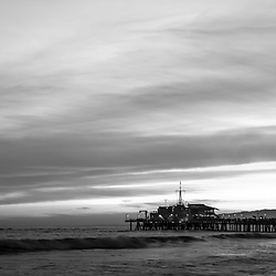 Santa Monica Pier at sunset black and white panorama picture along the Pacific Ocean in Southern California. Panoramic photo ratio is 1:3. Copyright ⓒ 2017 Paul Velgos with All Rights Reserved.