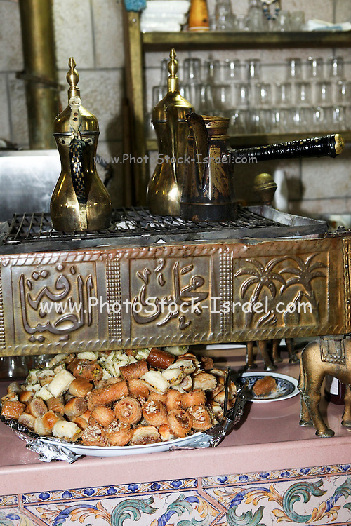 Middle Eastern Coffee in copper urns and Baklava (sweet pastry) dessert