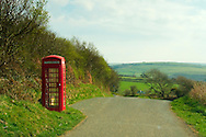 The traditional telephone booth at a secondary rural road