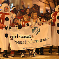 Adam Robison | BUY AT PHOTOS.DJOURNAL.COM<br /> The Girl Scouts make their way west on Main Street as they walk in the Tupelo Christmas Parade Friday night.