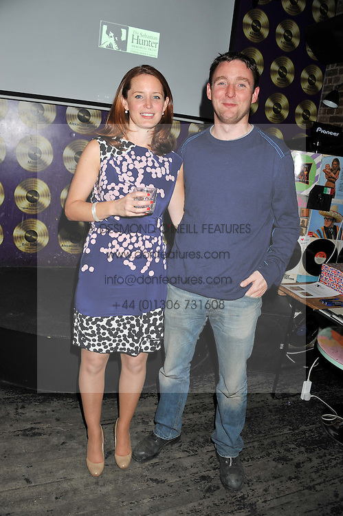 Left to right, LAURA WALFORD and her brother JAMES HUNTER at a party in aid of the Sebastian Hunter Memorial Trust held at Bunga Bunga, 37 Battersea Bridge Road, London SW11 on 21st June 2012.