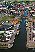 Nederland, Zuid-Holland, Maassluis, 23-05-2011; oude en nieuwe haven en oude centrum van Maassluis met Grote Kerk..View on Maassluis, historical city along the Nieuwe Waterweg, the old and new harbour..luchtfoto (toeslag), aerial photo (additional fee required).copyright foto/photo Siebe Swart