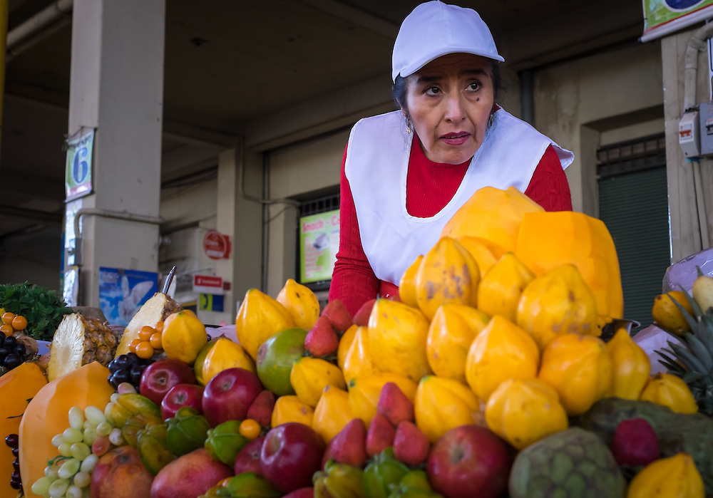 AREQUIPA, PERU - CIRCA APRIL 2014: Merchant in one of the juice stalls at the San Camilo market in Arequipa. Arequipa is the Second city of Perú by population with 861,145 inhabitants and is the second most industrialized and commercial city of Peru.