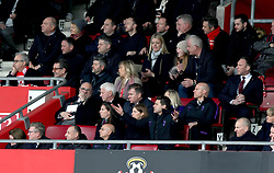 Tottenham Hotspur manager Mauricio Pochettino gestures from the stands (bottom row, centre) during the Premier League match at St Mary's Stadium, Southampton.