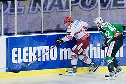 Toni Dahlman (HK Acroni Jesenice, #6) vs Kevin Kantee (HDD Tilia Olimpija, #42) with Slovene soldier during ice-hockey match between HDD Tilia Olimpija and HK Acroni Jesenice in 41st Round of EBEL league, on Januar 23, 2011 at Hala Tivoli, Ljubljana, Slovenia. (Photo By Matic Klansek Velej / Sportida.com)