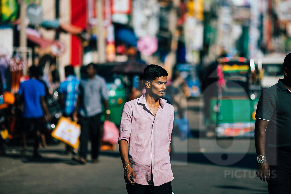 Pedestrian in the late afternoon at the central market and bus station in downtown Jaffna, Sri Lanka, Asia