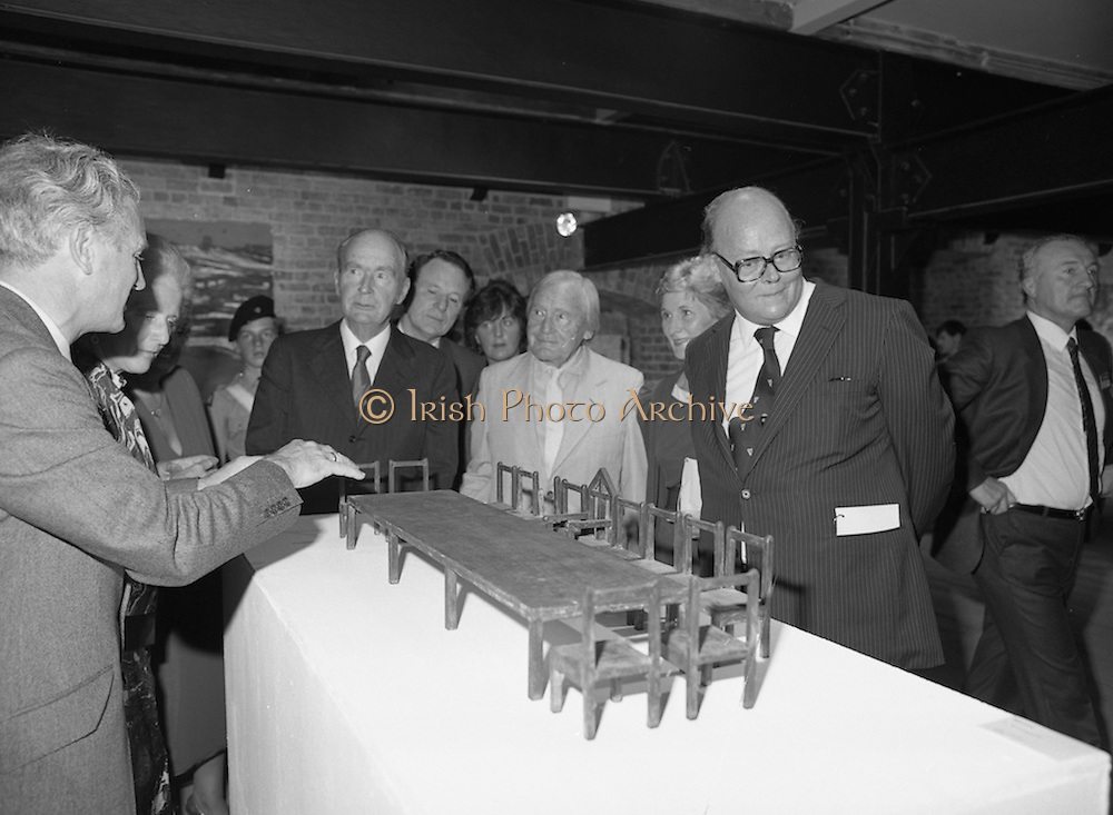 24/08/1984<br /> 08/24/1984<br /> 24 August 1984<br /> Opening of ROSC '84 at the Guinness Store House, Dublin. Mr Pat Murphy ROSC Chairman, gives a description of this representation of the Last Supper to (l-r): Maeve Hillery; President Patrick Hillery; Minister of State for Arts and Culture Ted Nealon; Michael Scott and Lord Iveagh.