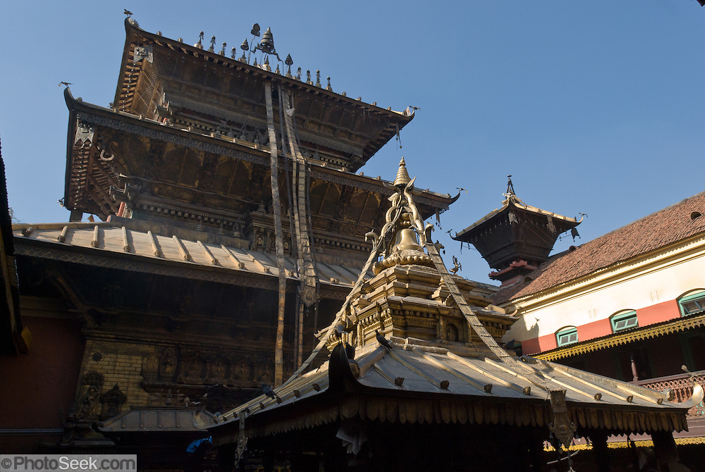 "Golden Temple (Hiranya Varna, or Suwarna Mahavihara) is a Buddhist Monastery existing since 1409 or earlier, located just north of Patan's Durbar Square, in Nepal, Asia. Patan was probably founded by King Veer Deva in 299 AD from a much older settlement. Patan, officially called Lalitpur, the oldest city in the Kathmandu Valley, is separated from Kathmandu and Bhaktapur by rivers. Patan (population 190,000 in 2006) is the fourth largest city of Nepal, after Kathmandu, Biratnagar and Pokhara. The Newar people, the earliest known natives of the Kathmandu Valley, call Patan by the name ""Yala""  (from King Yalamber) in their Nepal Bhasa language. UNESCO honored Patan's Durbar Square (Palace Square) as one of the seven monument zones of Kathmandu Valley on their World Heritage List in 1979. All sites are protected under Nepal's Monuments Preservation Act of 1956."