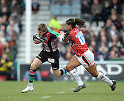 Twickenham, GREAT BRITAIN, Harlequins', David STRETTLE, hands of Saracens, Noah CATO, during the  Guinness Premiership match,  Harlequins vs Saracens at The Stoop Stadium, Surrey on Sat. 07.03.2009.  [Photo. Peter Spurrier/Intersport-images]