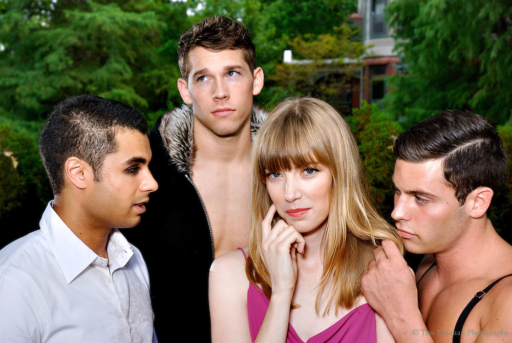 young woman being admired by group of young men