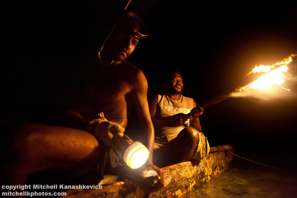 Men of Rah Lava Island looking for lobster in a lagoon, Rah Lava Island, Torba Province, Vanuatu