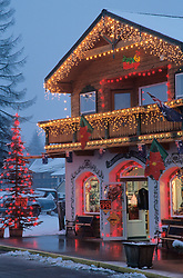 North America, USA, Washington, Leavenworth. Christmas lights add festive air to Front Street at dusk