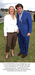 Actor OLIVER TOBIAS and his wife ARABELLA, at a polo match in West Sussex on 18th July 2004.PXG 108