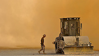 101123-N-6436W-010<br /> KHILAGUY, Afghanistan- A Seabee assigned to Naval Mobile Construction Battalion FORTY walks to his equipment in a cloud of dust created by a nearby departing helicopter Nov.23, 2010 in Khilaguy, Afghanistan. US Navy Photo by Chief Mass Communications Specialist Michael B. Watkins