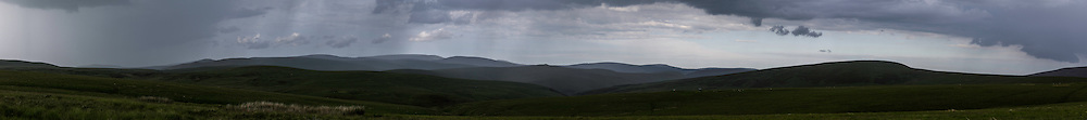 Broad Flow, Pennine Way, Cheviot Hills, Northumberland, UK. 5th July 2015. Looking east on a stormy summers day on the Scottish English Border.